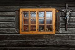 Podbiel village in Orva region. Traditional log cabin with a crucifix, Orava region, Slovakia stock images