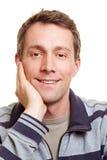 podbródka ręki szczęśliwy mężczyzna Obraz Stock