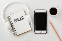 Podcast concept with smartphone and headphones stock images