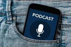 Podcast concept on smartphone screen in jeans pocket. All screen content is designed by me. Flat lay Stock Photos