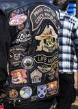 Different Embroidery on the back of a leather motorbike jacket. Podebrady, Czech republic - March 31, 2018: Embroidery on the back of a biker jacket in a royalty free stock photo
