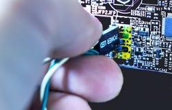 Poder conecting da mão humana conduzido Imagens de Stock Royalty Free