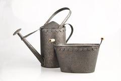 Poder y cesta de riego Fotos de archivo libres de regalías