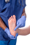 Podiatrist. Doctor pointing to problem area that has cmoon podiatry complaint Royalty Free Stock Photography