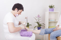 Podiatrist at work Stock Image