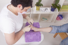Podiatrist at work Royalty Free Stock Photography