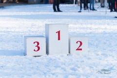 Podio del ganador en nieve imagen de archivo libre de regalías