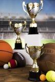 Podio di sport, tazze del premio dei vincitori Immagini Stock Libere da Diritti