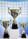 Podio di sport, tazze del premio dei vincitori Fotografia Stock
