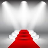 Podio illuminato della fase con il vettore del tappeto rosso Immagine Stock