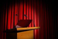 Podium del seminario y cortina roja Fotografía de archivo
