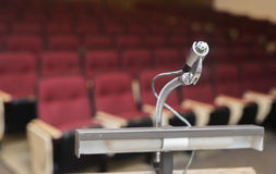 Podium with empty lecture hall background Royalty Free Stock Photos