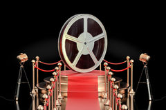 Podium with film reel, presentation concept. 3D rendering. Isolated on black background Stock Photos