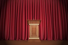 Podium and microphone in center of theatrical stage Stock Photos