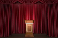 Podium and microphone in the center of the theatrical stage Royalty Free Stock Photography