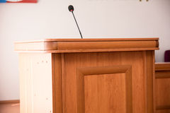 Podium with microphone in the hall for speaker Royalty Free Stock Photos