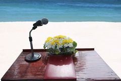The podium and microphone for ceremony on the beach. The podium and microphone provided for ceremony on the white sand beach royalty free stock photography
