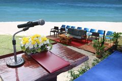 The podium and microphone for ceremony on the beach. The podium and microphone provided for ceremony on the white sand beach stock images