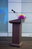 Podium with microphone for speaker presentation Royalty Free Stock Image