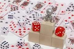 Podium with places on it dice. Figurine of people with a barbell on the podium with places on the background of dice Royalty Free Stock Image