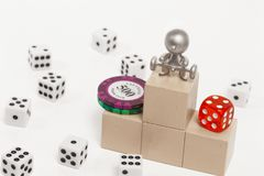Podium with places on it dice. Figurine of people with a barbell on the podium with places on the background of dice Stock Photos