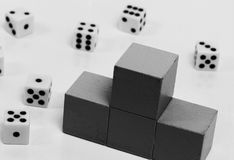 Podium with places on it dice. Figurine of people with a barbell on the podium with places on the background of dice Stock Image