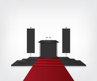 Podium with red carpet for award ceremony and flag Royalty Free Stock Image
