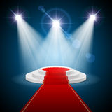 Podium. Round stepped  podium with red carpet and illuminated spotlights Stock Photo