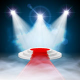 Podium. Round stepped white podium with red carpet and illuminated spotlights Stock Photography