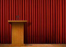 Podium on stage over red curtain. Image of a podium on stage over red curtain Royalty Free Stock Images