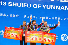 The podium of the top three. The first three female athletes stand on the podium.Half international marathon in fushui county in yunnan province in China, time Stock Photos