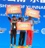 The podium of the top three. The first three male athletes stand on the podium.Half international marathon in fushui county in yunnan province in China, time: on Stock Photography