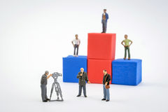 Podium winners, live of television, miniature figures Royalty Free Stock Image