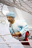 Podiumsskulptur des Mannes auf Schiff Lizenzfreies Stockfoto