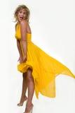 podmuchowy żółtą sukienkę Obrazy Stock