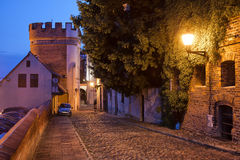 Podmurna Street and Bridge Tower by Night in Torun Royalty Free Stock Image