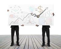 Podnośna deska z zegarowymi rękami i biznesów doodles Obrazy Royalty Free
