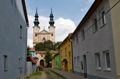 Podolinec town in northern Slovakia. A church in Podolínec - Slovakia. The town lies near the Poprad River, in the Spiš region. In the backround royalty free stock photography