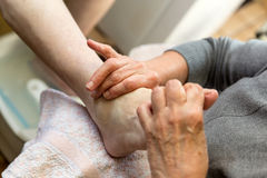 Podologist at a foot reflexology Royalty Free Stock Photo