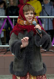 Song to bye the Maslenitsa. PODOLSK, OSTAFIEVO, RUSSIA - MARCH 17: Unidentified singer on Russian religious and folk holiday Maslenitsa in estate Ostafievo on Royalty Free Stock Images