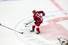 N. Komarov 19 dribble. PODOLSK, RUSSIA - OCTOBER 16, 2018: N. Komarov 19 dribble on hockey game Vityaz vs Severstal on Russia KHL championship on October 16 stock images