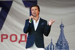 Alexey Zardinov sing a song on Day of the Moscow city event. PODOLSK, RUSSIA - SEPTEMBER 9, 2018: Alexey Zardinov sing a song on Day of the Moscow city event royalty free stock images