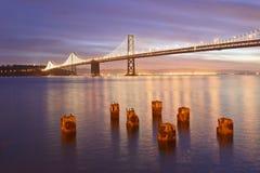 Podpalany most przy świtem Zdjęcia Stock