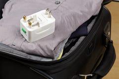 Podróżuje władza adaptator z włącznikami dla europejczyka i USA po, UK, fotografia royalty free