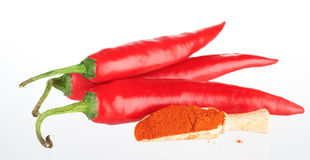 Pods of Chile hot pepper and chili powder in a wooden spoon Stock Photos