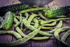 Pods of green beans and cucumber Royalty Free Stock Images