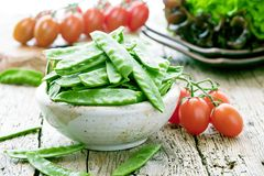 The pods of green beans on a wooden surface royalty free stock images