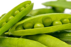 Pods of green peas isolated on a white background. Green, ripe, fresh vegetables. Legumes Royalty Free Stock Photography