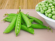 Pods sweet green peas and fresh beans Royalty Free Stock Images