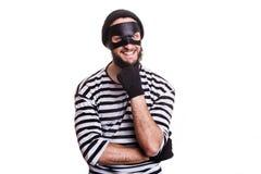 Podstępny kryminalny ono uśmiecha się i myśleć obraz royalty free